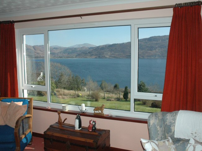 The lounge at Aultsigh B and B has a picture window giving magnificent views to the south across Loch Carron towards Attadale.